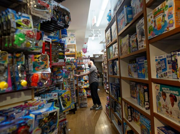 An employee organizes an aisle at Mary Arnold Toys, New York City's oldest toy store, on Aug. 2.