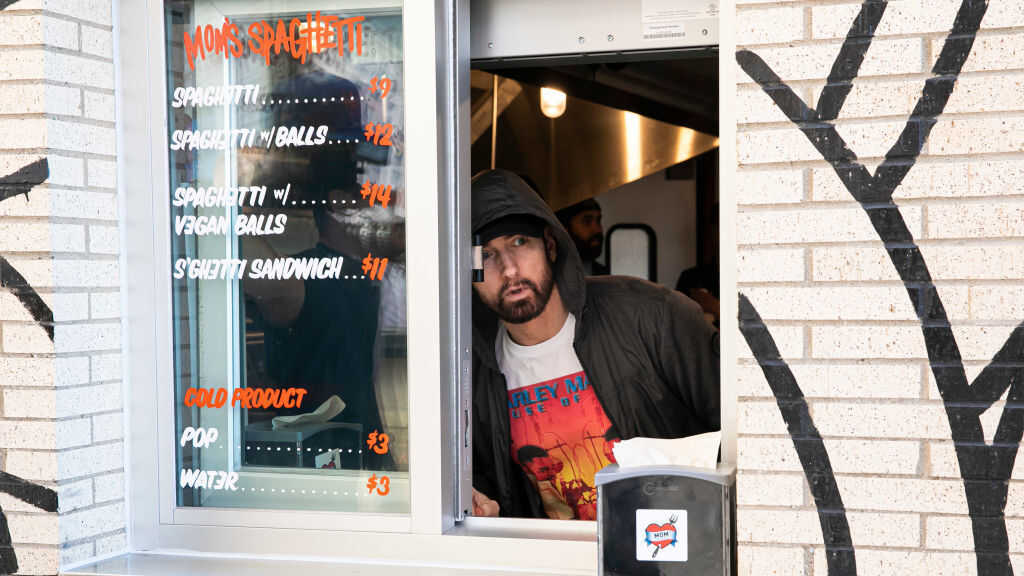 Eminem surprises fans at the opening of his 'Mom's Spaghetti' restaurant in Detroit