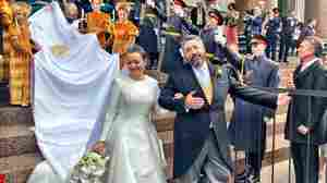 After a century of waiting, Russians witness a royal wedding once more