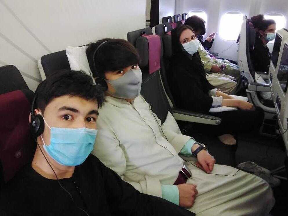 Members of the Afghanistan National Institute of Music on the plane to Doha