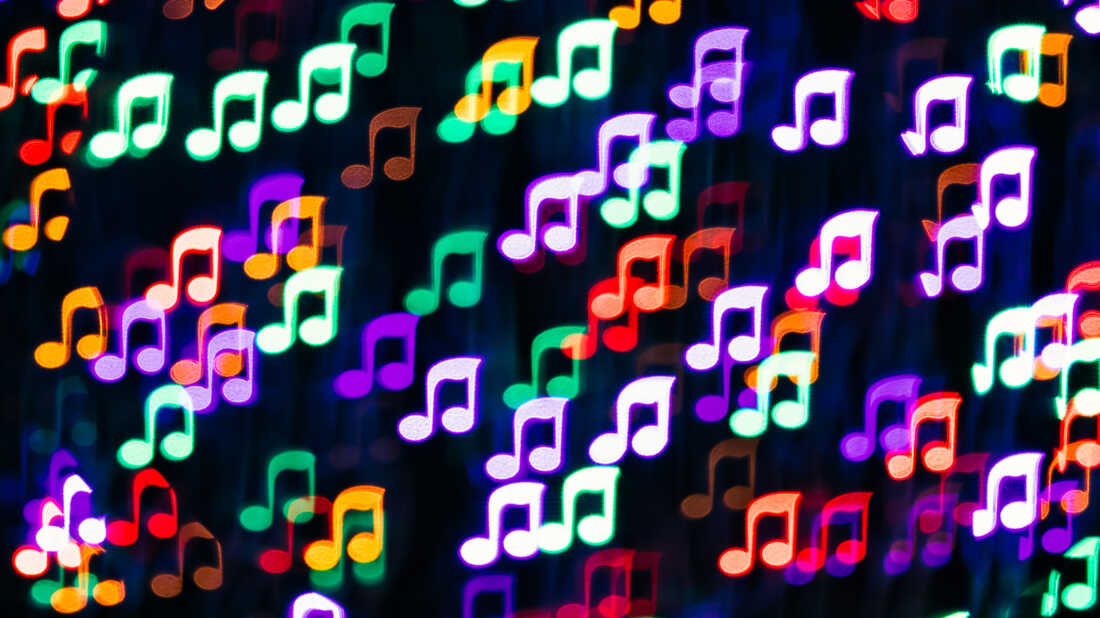 Multi Colored Musical Note Shape Bokeh Backdrop on Dark Background, Music Concept.