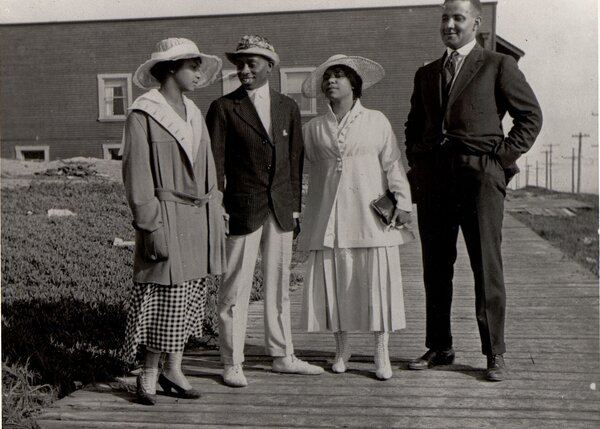 Two African American couples stand on a walkway at Bruce's Beach, Manhattan Beach, circa 1920.