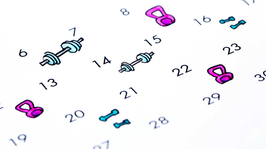 A calendar with hand drawn icons indicating weightlifting activities every other day.