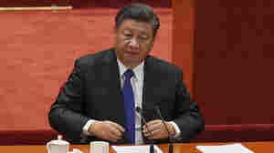China's Xi Jinping urges a 'peaceful reunification' with Taiwan