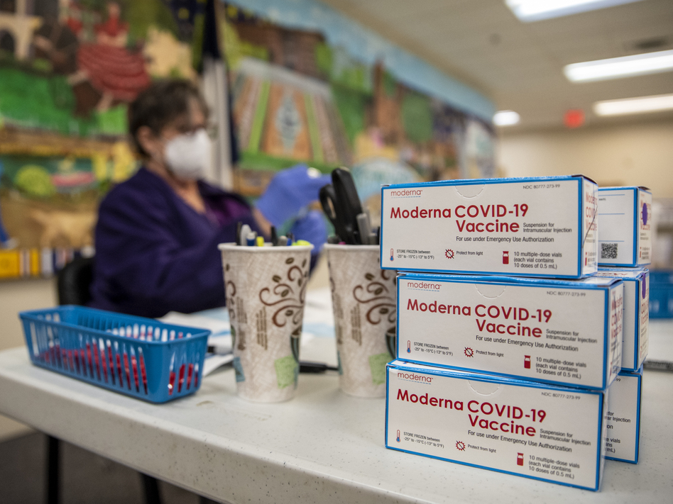 A nurse prepares a dose of the Moderna COVID-19 vaccine at a San Antonio senior center in March. A panel of advisers to the Food and Drug Administration will meet Thursday to review Moderna's booster shot.