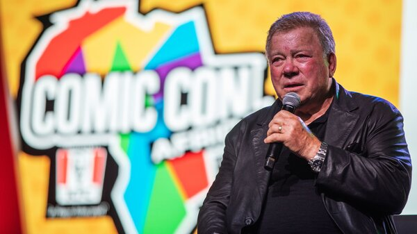 Canadian actor William Shatner, who became a cultural icon for his portrayal of Captain James T. Kirk in the Star Trek franchise, speaks from the stage at the second edition of the multi-genre entertainment comic and fan convention 'Comic Con Africa' in Johannesburg on September 21, 2019.
