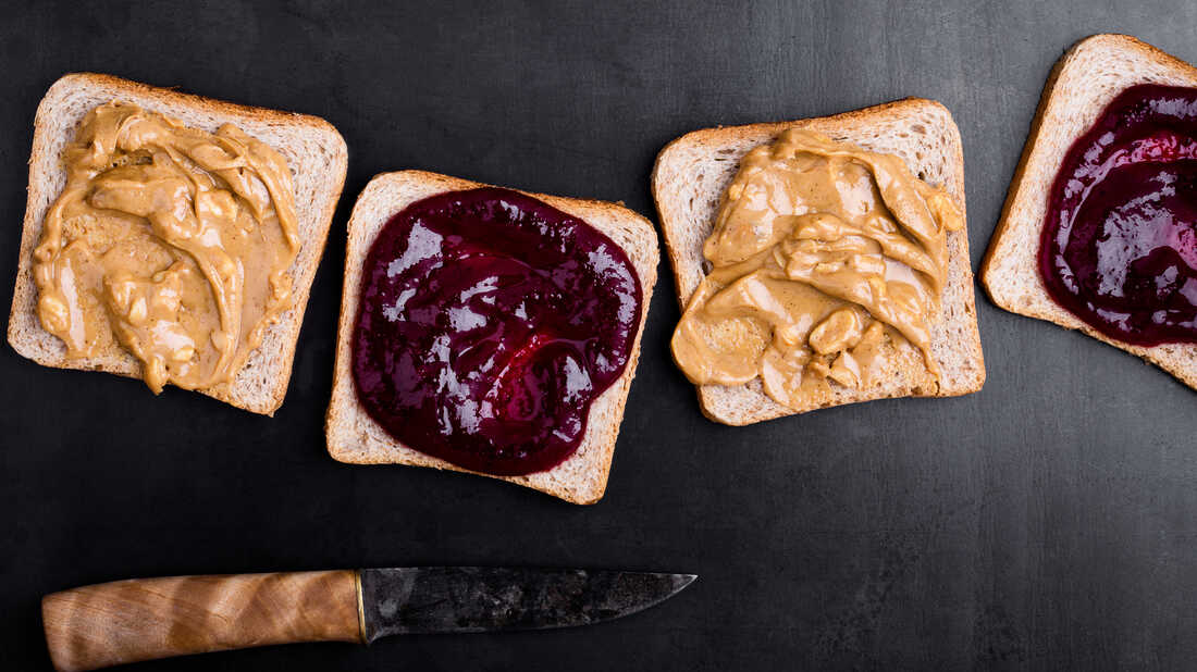 Making peanut butter and jelly sandwiches.
