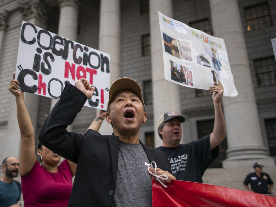 People and teachers protest against COVID-19 vaccine mandates outside the Manhattan Federal Court on Tuesday in New York.
