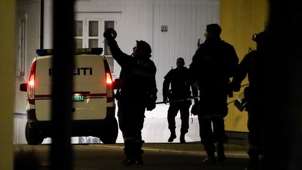 Police at the scene after an attack in Kongsberg, Norway, on Wednesday. Several people have been killed and others injured by a man armed with a bow and arrow.