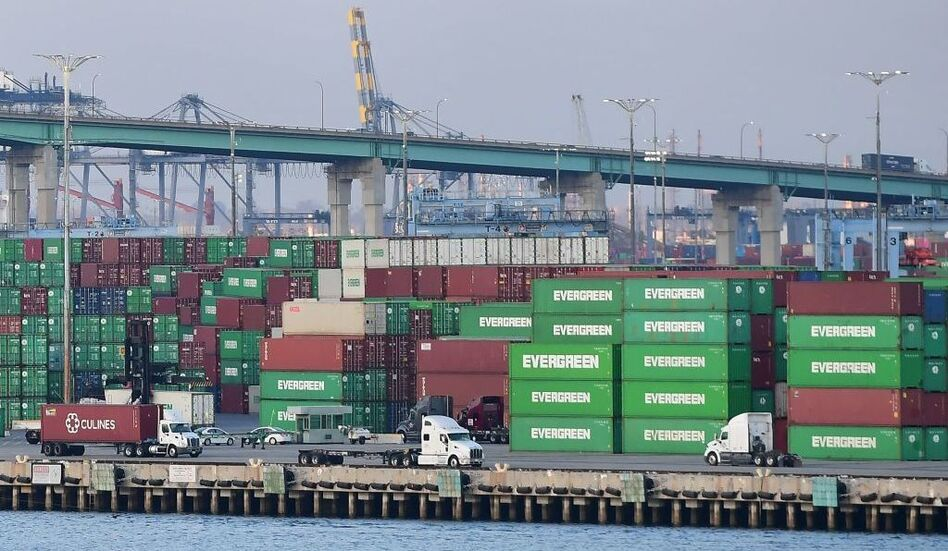 Containers are stacked high at the Port of Los Angeles on Sept. 28. A record number of cargo ships are stuck floating and waiting off the Southern California coast amid a supply chain crisis that the Biden administration is hoping to ease. (Frederic J. Brown/AFP via Getty Images)