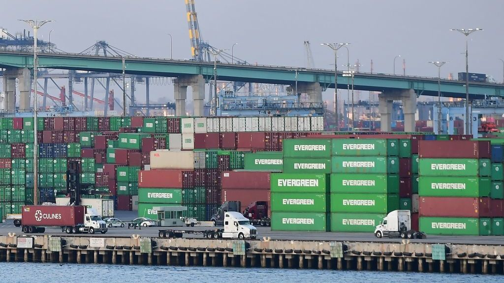 Containers are stacked high at the Port of Los Angeles on Sept. 28. A record number of cargo ships are stuck floating and waiting off the Southern California coast amid a supply chain crisis that the Biden administration is hoping to ease.