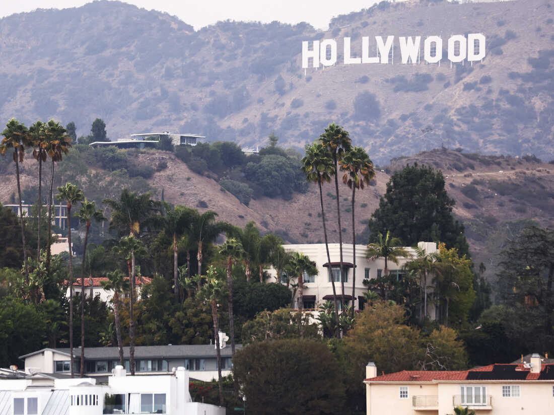 Hollywood crew members reach a tentative deal with major studios, averting a strike