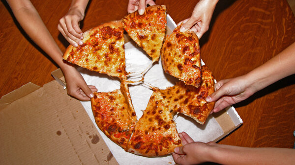 Restaurant food, like this pizza, and packaged foods are often high in salt to make them more palatable.