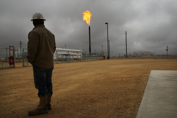 Flared natural gas is burned off at Apache Corporation's operations at the Deadwood natural gas plant in Garden City, Texas, on Feb. 5, 2015.