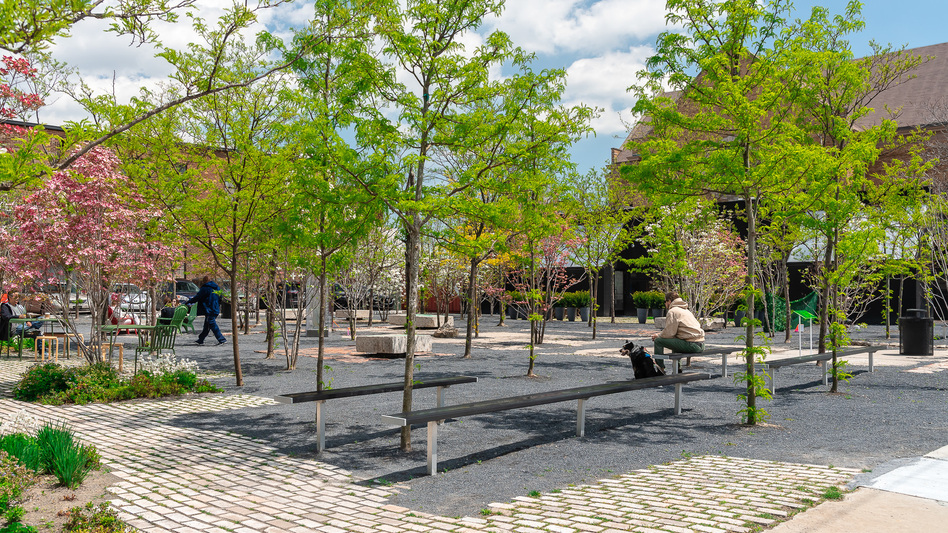 A desolate parking lot filled with weeds and debris was transformed into Core City Park in Detroit, Mich. Nearly everything used in the construction of the park was found on site — the benches, for example were recycled from old concrete walls.