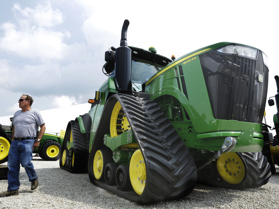 John Deere is known for its signature green and yellow farm equipment, like this equipment on display in 2015 at the Farm Progress Show in Decatur, Ill.