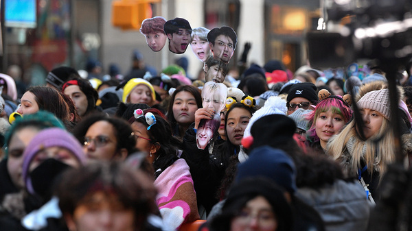 Fans await the K-pop boy band BTS visit to the Today show at Rockefeller Plaza in New York City last year.