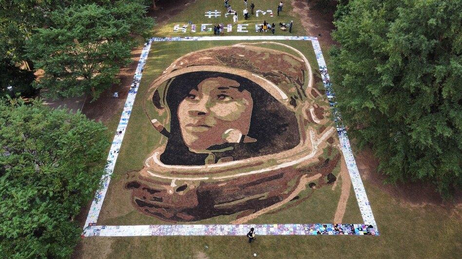 Artist Stan Herd's portrait of NASA astronaut Stephanie Wilson on display in Atlanta is 70 feet by 90 feet. (John Zarr/Earthworks)