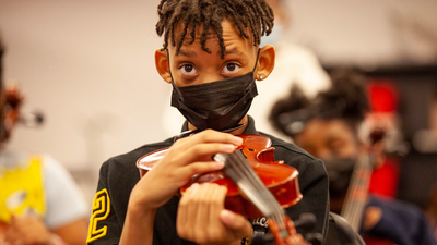 Returning to in-person instruction, Ms. Sharp's orchestra class doesn't hold back