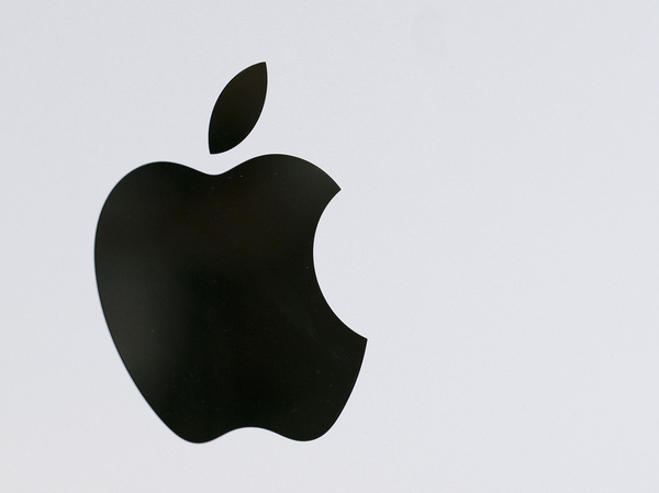 The Apple logo is displayed on a Mac Pro desktop computer on May 21 in New York.