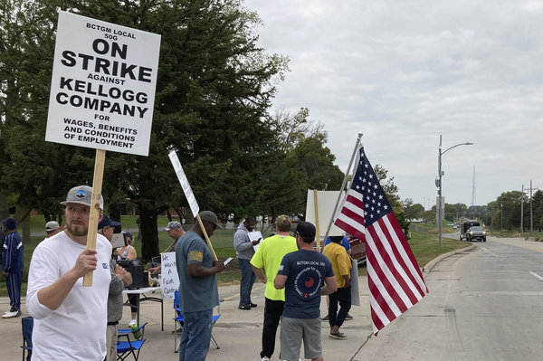 Workers from a Kellogg cereal plant picket along the main rail lines leading into the facility on Oct. 6 in Omaha, Neb. Workers have gone on strike after a breakdown in contract talks with company management.