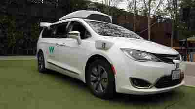 Self-driving Waymo cars gather in a San Francisco neighborhood, confusing residents