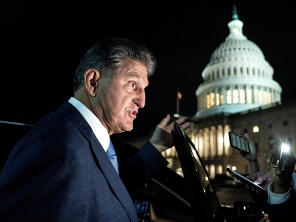 Sen. Joe Manchin, a Democrat from West Virginia, speaks to members of the media while departing the U.S. Capitol on Oct. 7. Manchin has reportedly told the White House that he opposes the key climate measure in Biden's multitrillion-dollar climate and social programs package.