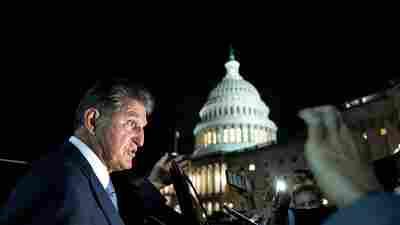 Joe Manchin's objections to a clean energy program threaten Biden's climate promises