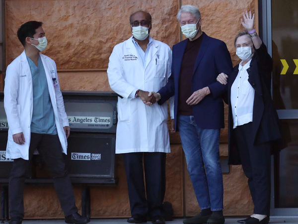 Former President Bill Clinton, standing with his wife, Hillary, and doctors, was discharged from UC Irvine Medical Center Sunday morning.