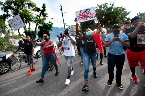 Demonstrators march on June 4, 2020 in Brunswick, Ga., after a court appearance by Gregory and Travis McMichael, two suspects in the fatal shooting of Ahmaud Arbery.