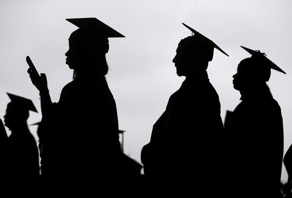 New graduates line up before the start of a community college commencement in East Rutherford, N.J., on May 17, 2018.