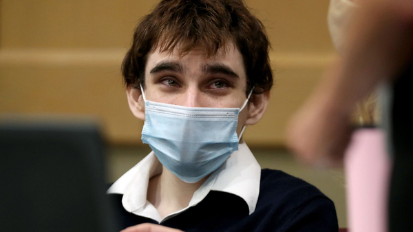 Nikolas Cruz pleaded guilty to 17 counts of murder in the Parkland school shootings on Wednesday. He's seen here sitting at the defense table in the Broward County Courthouse in Fort Lauderdale, Fla., on Oct. 6.