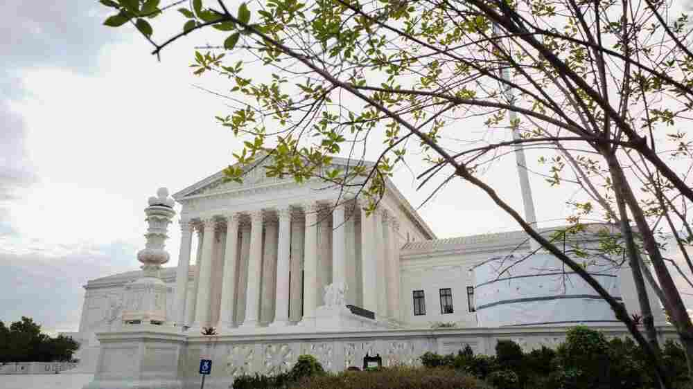 The Supreme Court keeps Texas abortion law in place, but agrees to review it