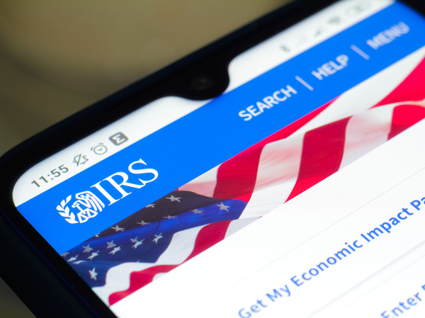 The Internal Revenue Service (IRS) logo is seen displayed on a smartphone in this photo illustration. A battle over taxes continues to brew as the IRS is seeking to obtain more bank account information, a move strongly opposed by Republicans and the lenders themselves.