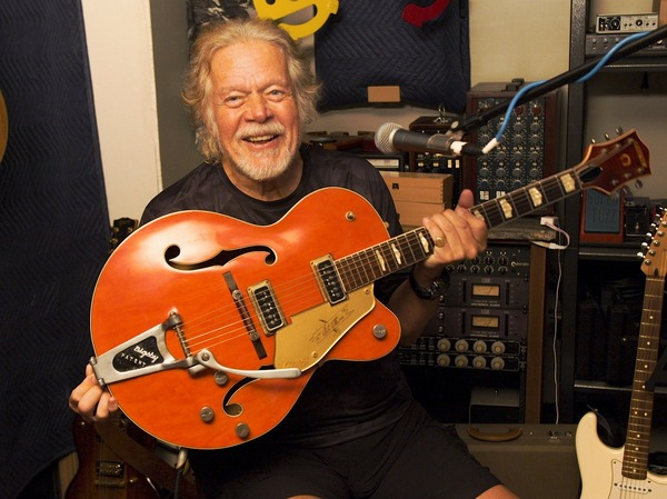 Randy Bachman holds a Gretsch guitar that is similar to the one stolen in 1976. He plans to swap this one for his original with TAKESHI, a Japanese musician who bought Bachman's beloved instrument in 2016.