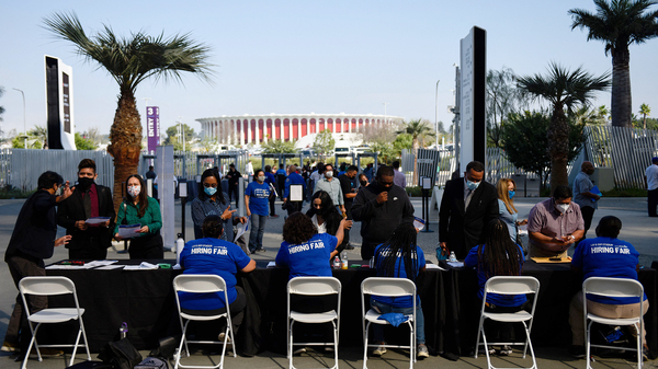 Los Angeles International Airport and SoFi Stadium employers spoke with potential job applicants at a job fair in Inglewood, Calif., in September. About 19% of all households in an NPR poll say they lost all their savings during the COVID-19 outbreak, and have none to fall back on.