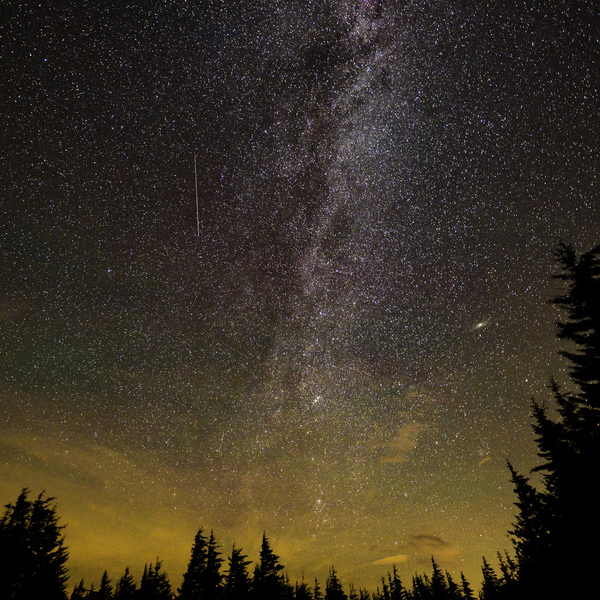 In this 30 second exposure, a meteor streaks across the sky during the annual Perseid meteor shower on Aug. 10, 2021, in Spruce Knob, West Virginia.
