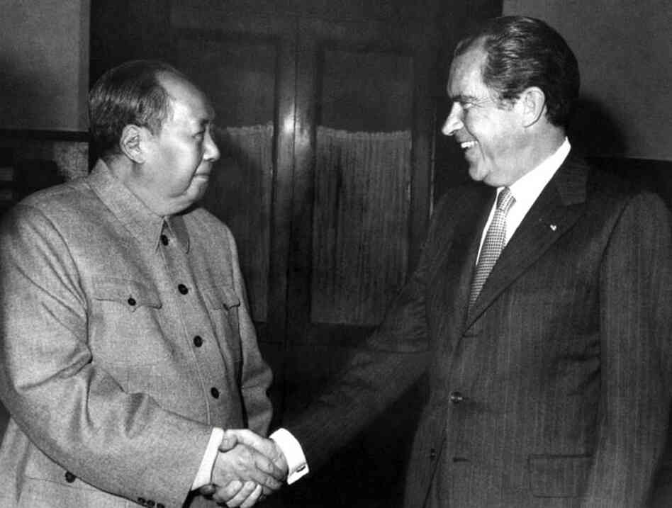 Chinese President Mao Zedong shakes hands with Richard Nixon in Beijing, 1972