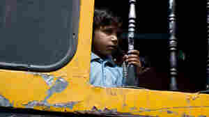 A boy looks out the window of a bus near Aligarh, India, on the Grand Trunk Road.