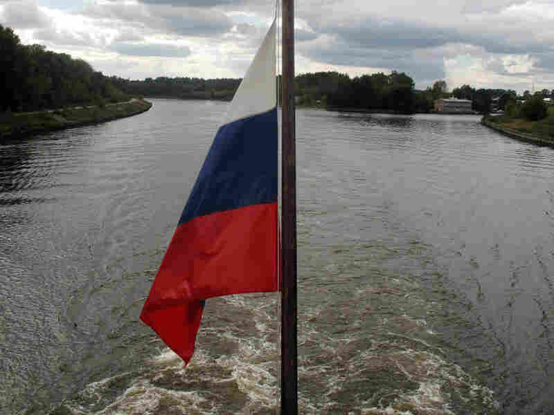 The Russian flag hangs from a cruise ship travelling down the Volga River.