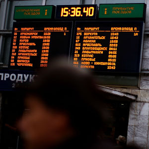 The schedule board at Yaroslavsky station lists the departure times and platform numbers of trains outbound from Moscow. (David Gilkey/NPR)