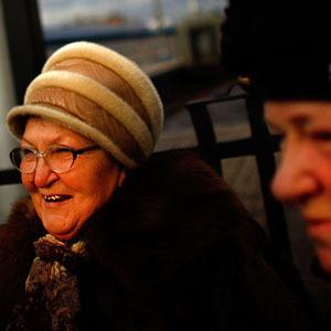 Tamara Ostrovskaya (left) and her sister-in-law, Albina Ostrovskaya, stand on the platform at Yaroslavsky station. Tamara is embarking on a three-day trip to Krasnoyarsk, in central Siberia. (David Gilkey/NPR)
