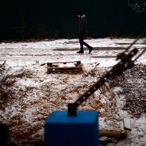 A man walks along iced-over train tracks along the Trans-Siberian railroad. (David Gilkey/NPR)