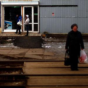 A woman waits for a local train at a small station along the Trans-Siberian railroad. (David Gilkey/NPR)