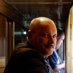 Yovlev, who works for the railroad, stands outside his train compartment during the trip to Yaroslavl, his hometown. (David Gilkey/NPR)