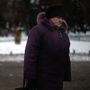 An old woman walks through a park in Rybinsk. (David Gilkey/NPR)