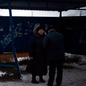People wait at an open-air bus shelter outside of Rybinsk. (David Gilkey/NPR)