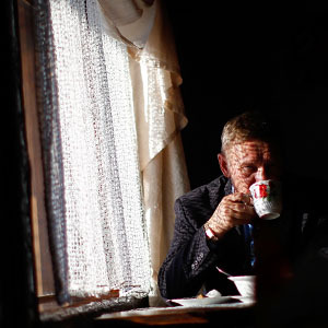 A man sips his tea in a roadside cafe on the highway between the city of Ulan-Ude and Lake Baikal. (David Gilkey/NPR)
