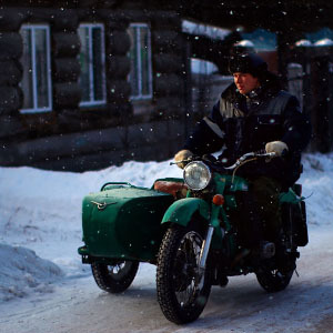 A man rides his motorcycle slowly on the town's ice-covered streets. (David Gilkey/NPR)