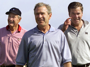 Photo of Jeb posing with H.W. and W. on golf course